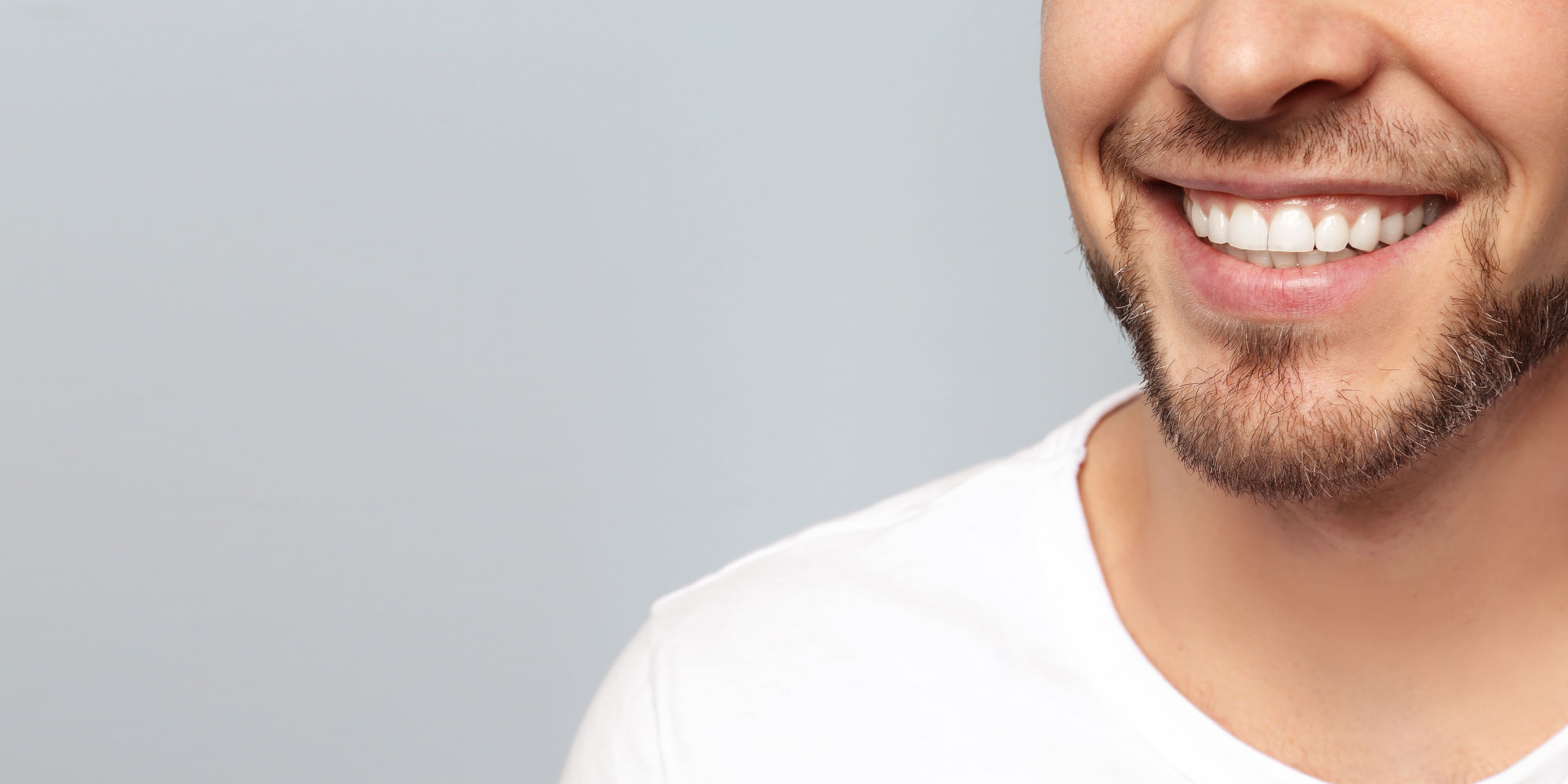dental patient smiling after periodontal treatment